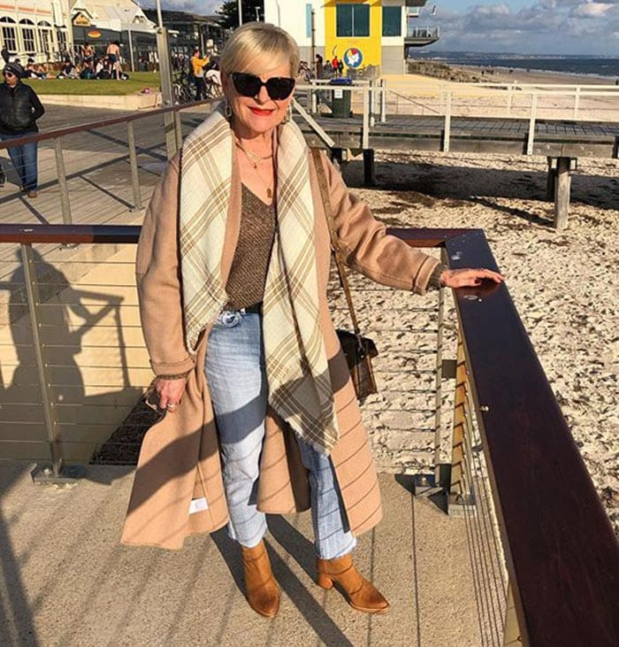 Marina wears tan booties with jeans   40plusstyle.com