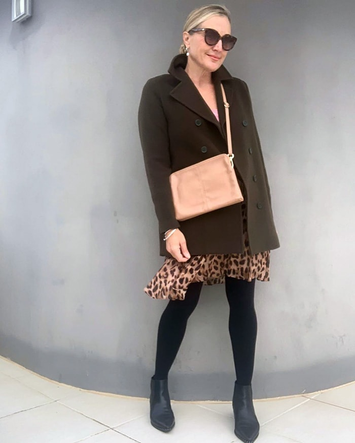 Melinda wears opaque tights with her leopard print skirt | 40plusstyle.com