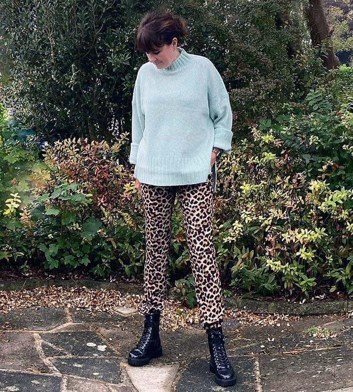 Michelle in a wool sweater and lace-up boots with leopard print pants   40plusstyle.com