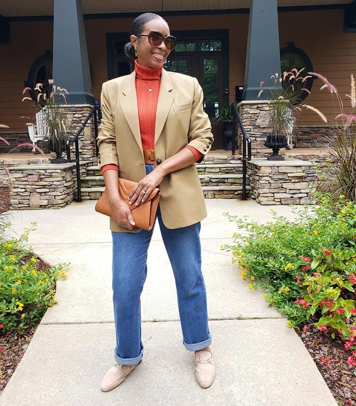 Mo wears a blazer with jeans | 40plusstyle.com