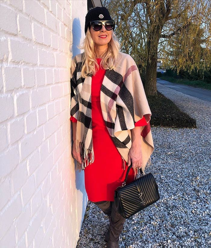 Nadine wears a red and black outfit   40plusstyle.com