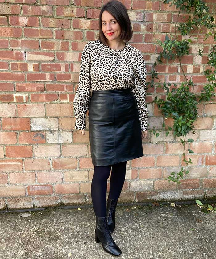 Nikki wears a leather skirt and blouse   40plusstyle.com