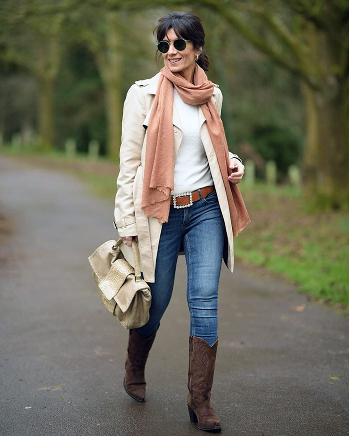 Winter wardrobe - Patricia wears skinny jeans and cowboy boots   40plusstyle.com
