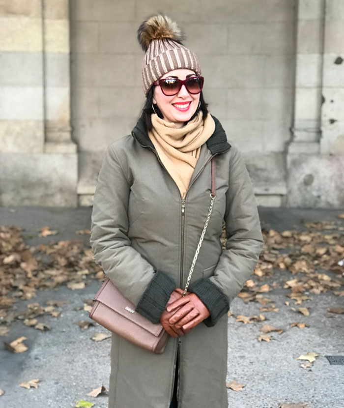 Patrician wears tan gloves with her winter outfit   40plusstyle.com