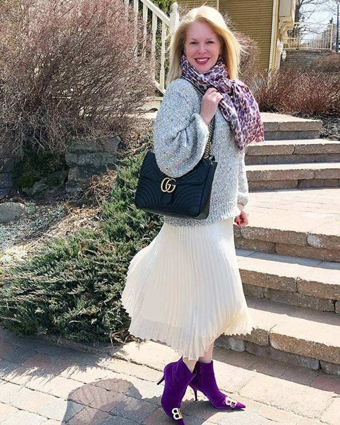 Ruisio wears purple boots with her outfit | 40plusstyle.com