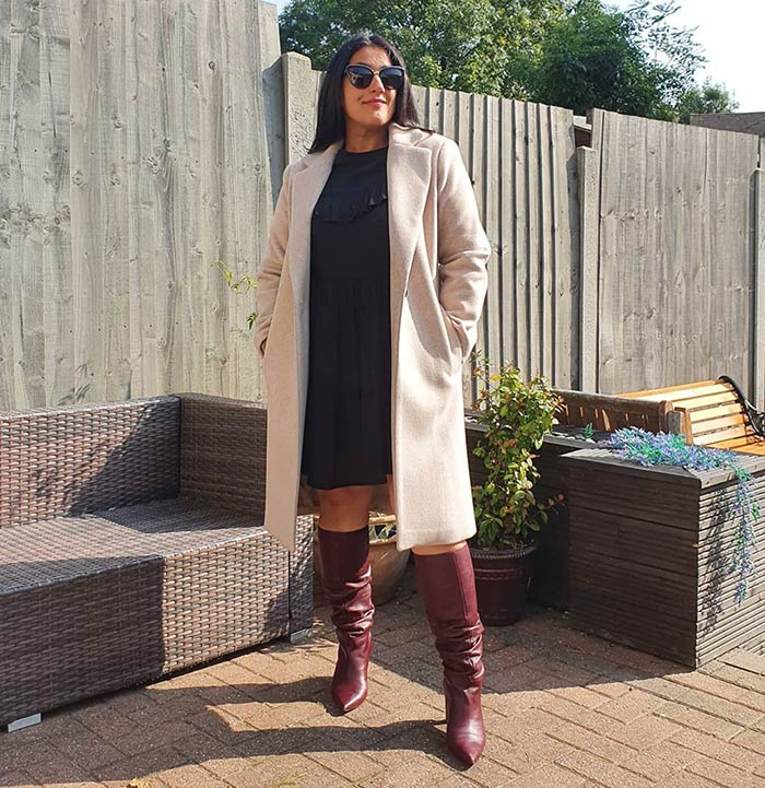 Winter capsule wardrobe - Jas wears a neutral outfit with burgundy booties   40plusstyle.com