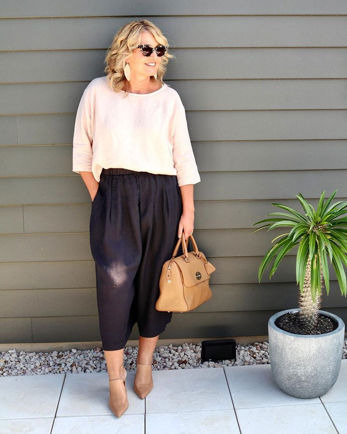 Bev wears wide-legged pants and heels | 40plusstyle.com