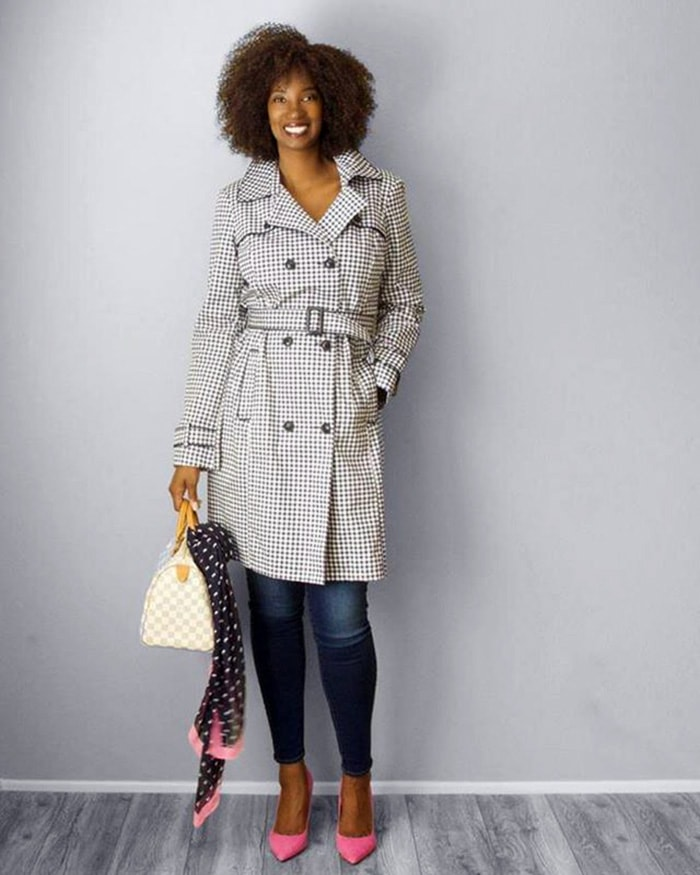 How to dress for Thanksgiving - Tanasha wears a raincoat with her jeans | 40plusstyle.com