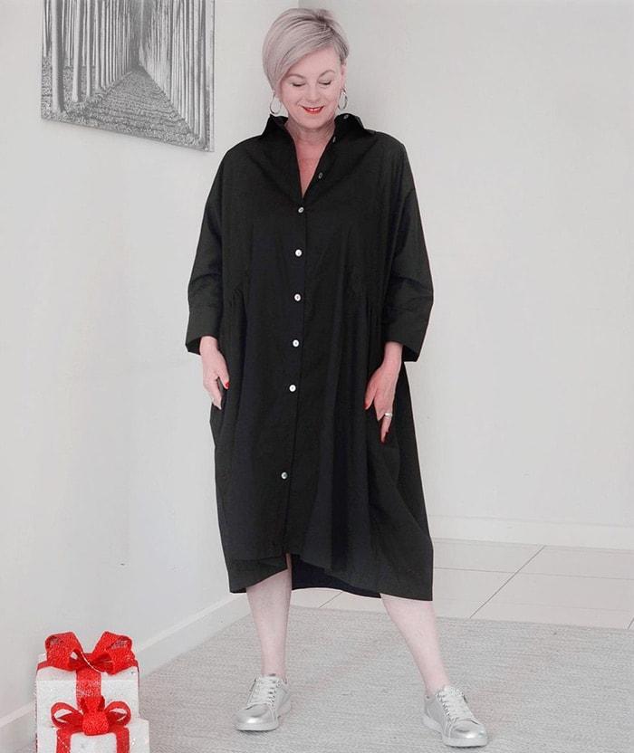 Deborah wears a black shirt dress   40plusstyle.com