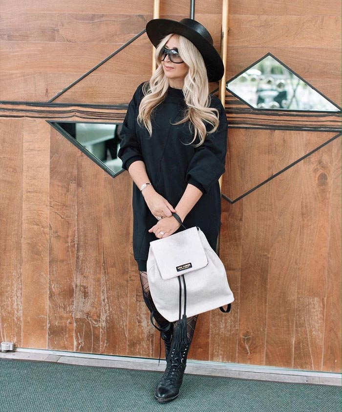 Gala wears a black sweater dress   40plusstyle.com
