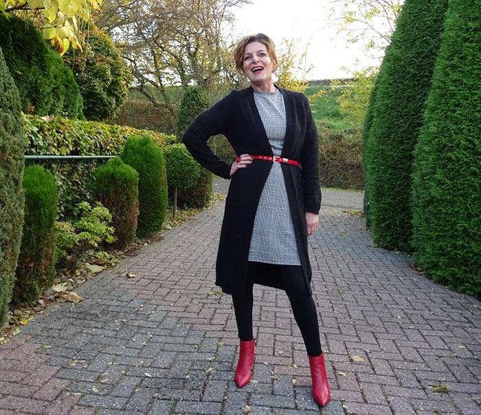 Nancy wears a belt over her knitwear | 40plusstyle.com