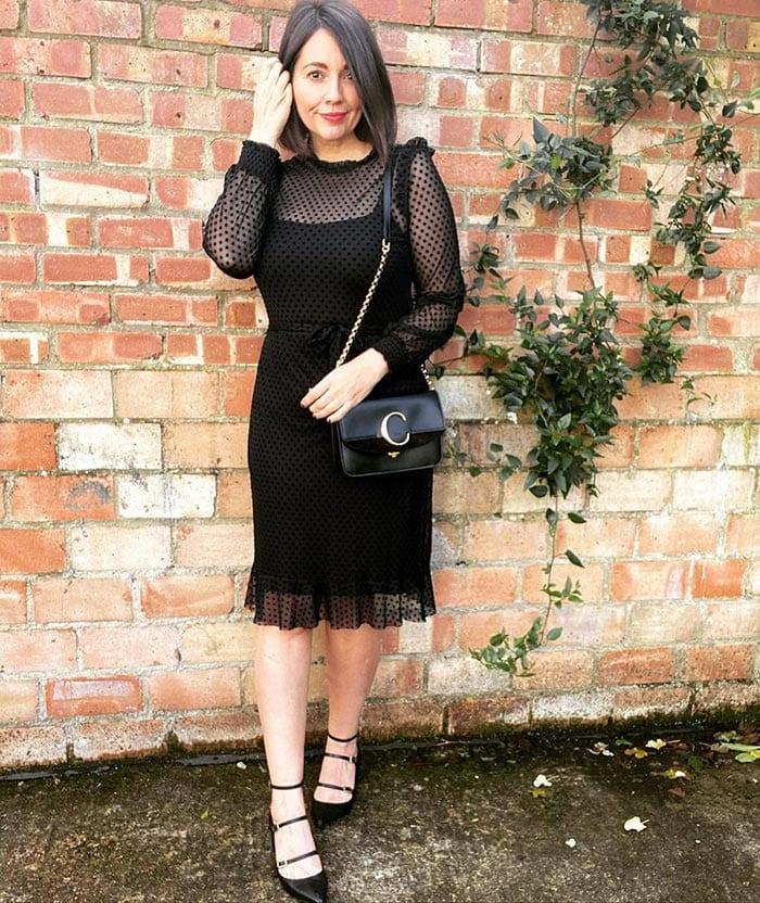 Nikki wearing a black polka dot cocktail dress   40plusstyle.com