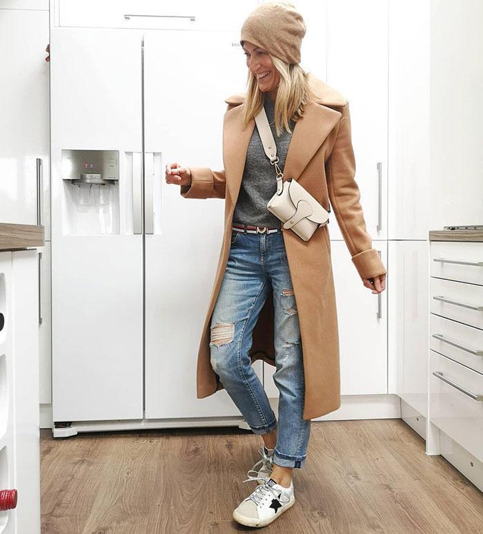 Abi wears a beige beanie to match her coat | 40plusstyle.com