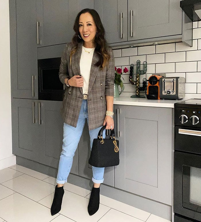 Abi adds subtle accessories to her outfit | 40plusstyle.com