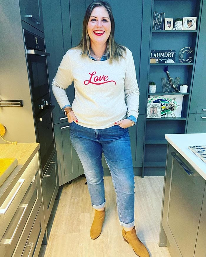 Caroline in a fun sweater and jeans | 40plusstyle.com