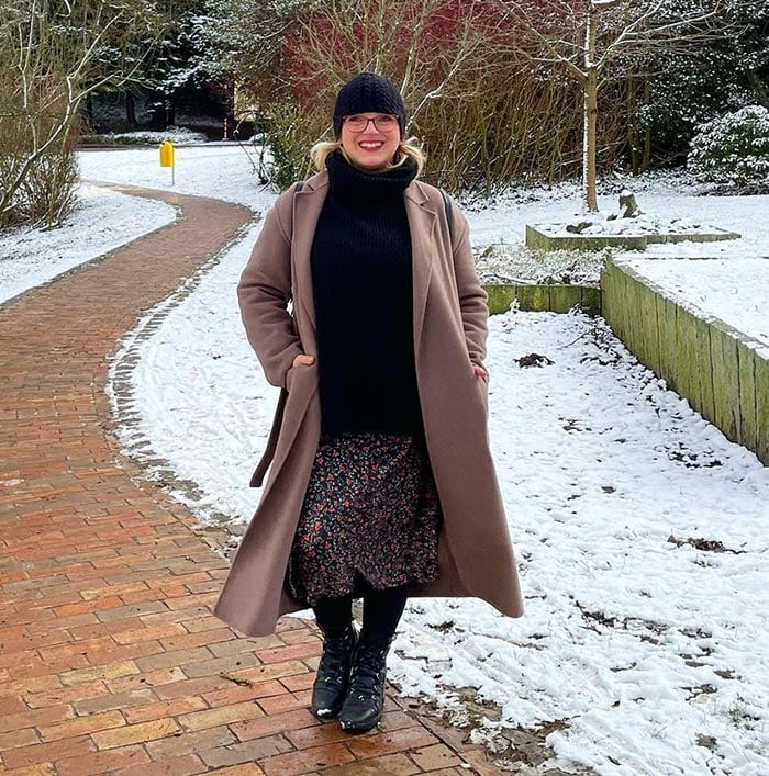 Katharina wears a coat over her winter skirt | 40plusstyle.com
