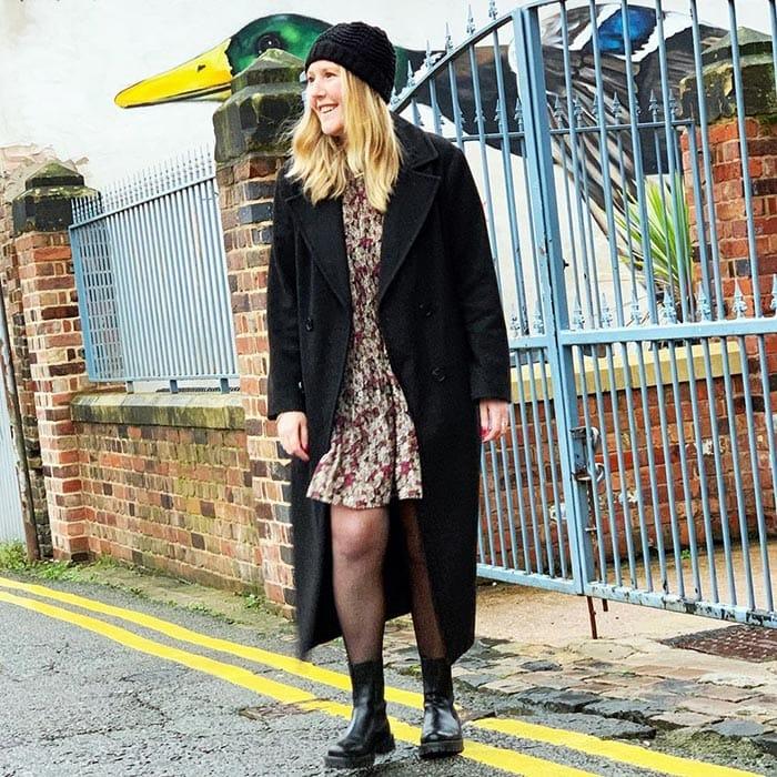 Kerri in a black beanie and matching coat | 40plusstyle.com