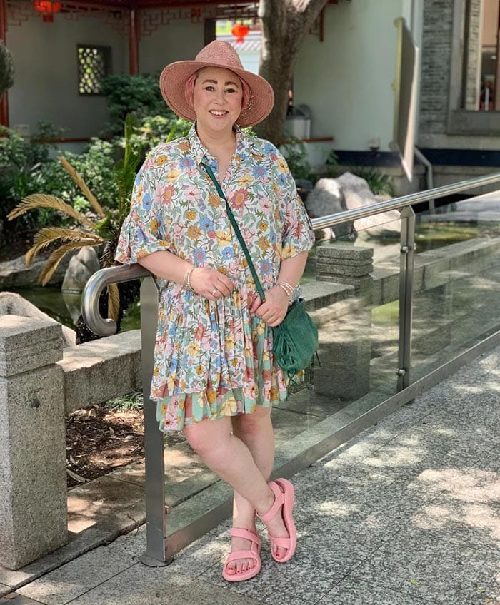 Kim in a printed floral dress, sandals and hat | 40plusstyle.com