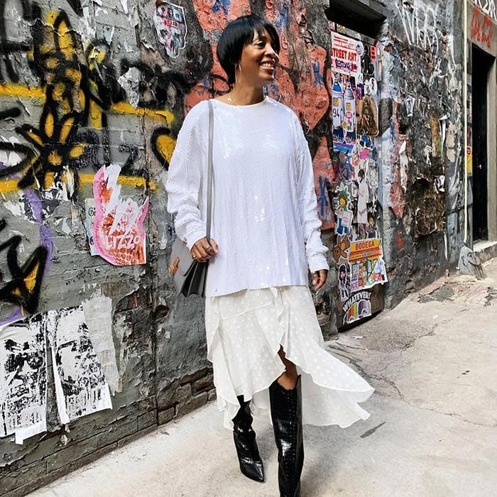how to dress after 40 - Kim wears a white outfit and long boots | 40plusstyle.com