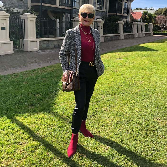 Marina wears red boots and leather pants   40plusstyle.com