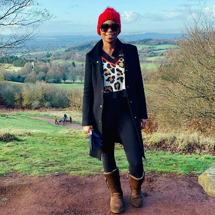 Mejacal in a red beanie | 40plusstyle.com