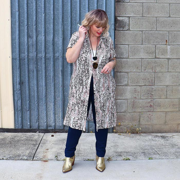 Mel wearing a printed topper, jeans and booties  | 40plusstyle.com