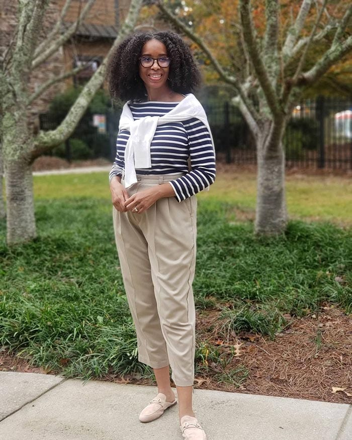 Mo wearing a striped top, pants and mules   40plusstyle.com