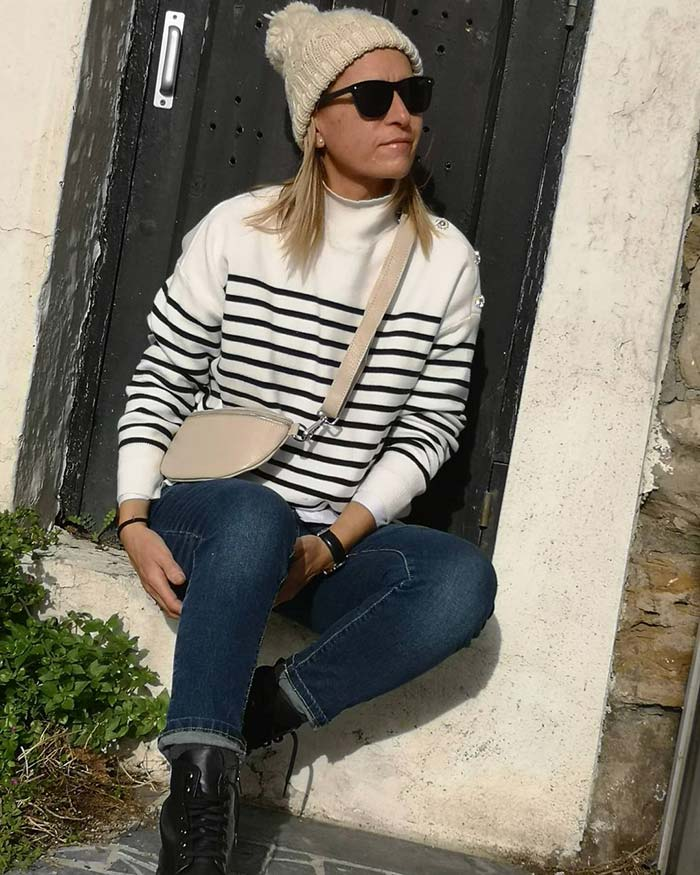 Nagore wears a cream beanie hat | 40plusstyle.com