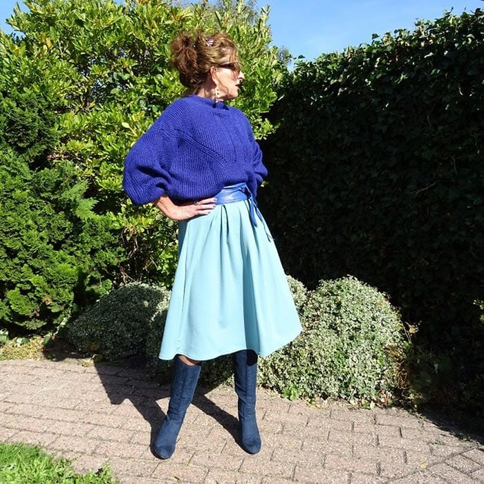 Nancy wearing a sweater with her winter skirt outfit | 40plusstyle.com