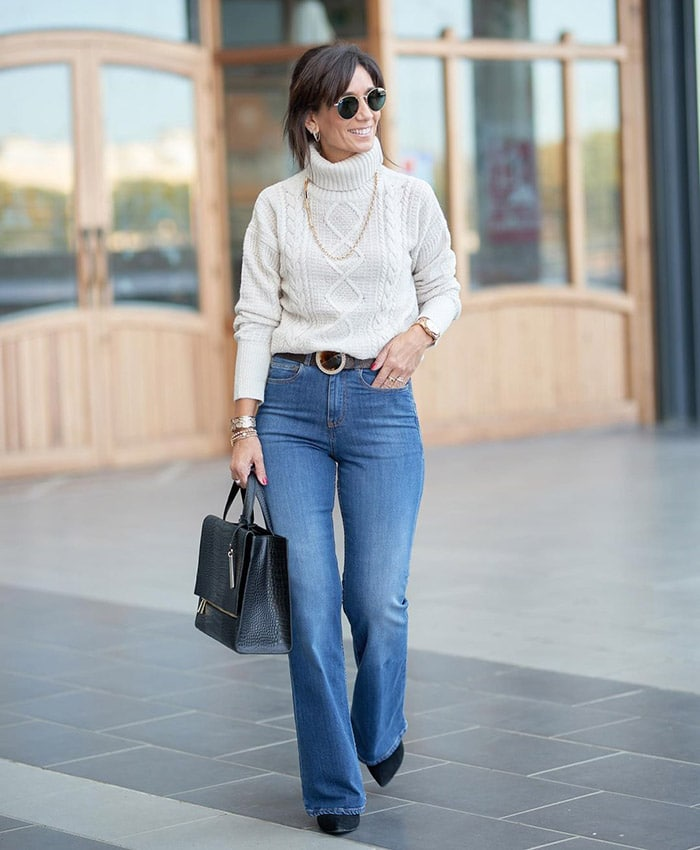 Patricia wears a sweater and jeans   40plusstyle.com