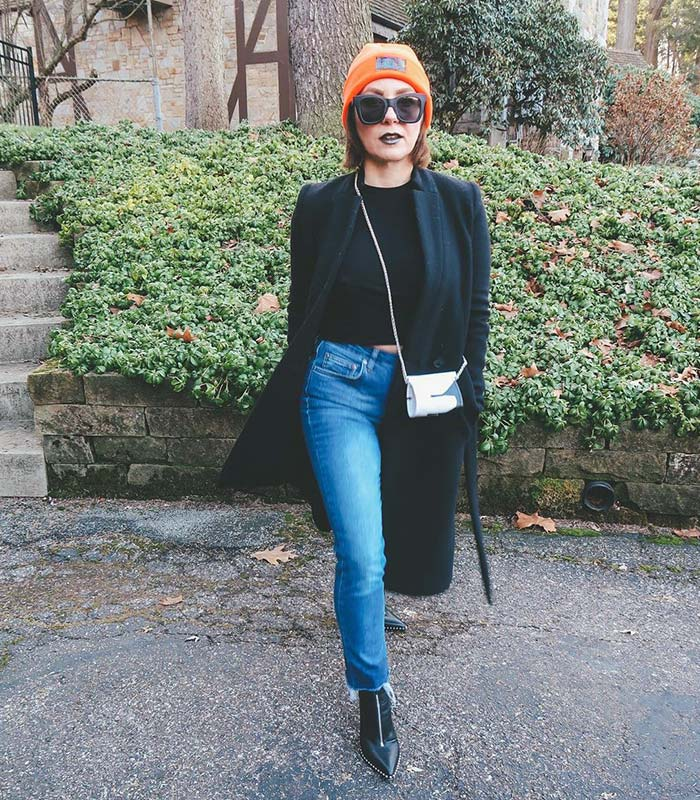 Terra adds color to her outfit with an orange hat | 40plusstyle.com