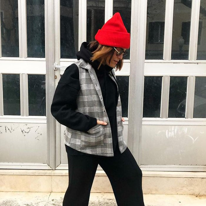 Vianei wears her red hat pulled up into a point | 40plusstyle.com