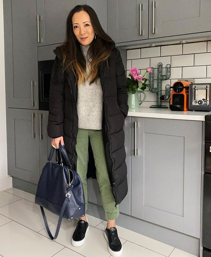 Abi in black sneakers with white soles | 40plusstyle.com