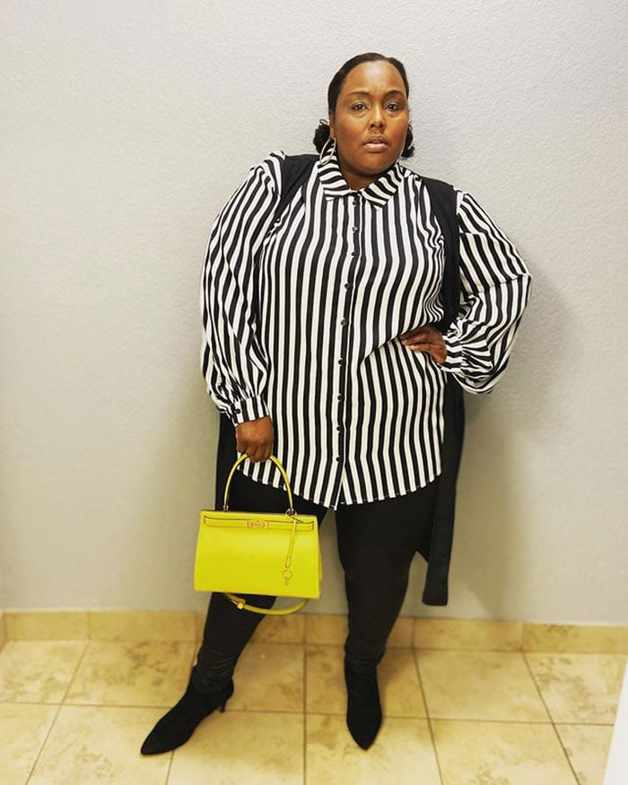 Tops to hide your tummy - Jennifer wears a striped blouse | 40plusstyle.com