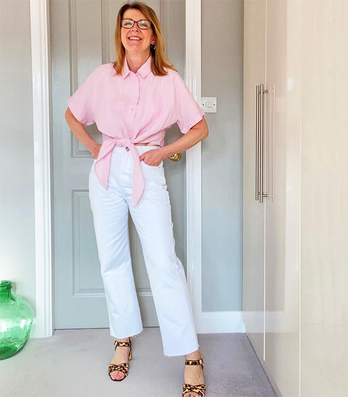 Best white jeans - Helen wears white jeans and a tie top | 40plusstyle.com