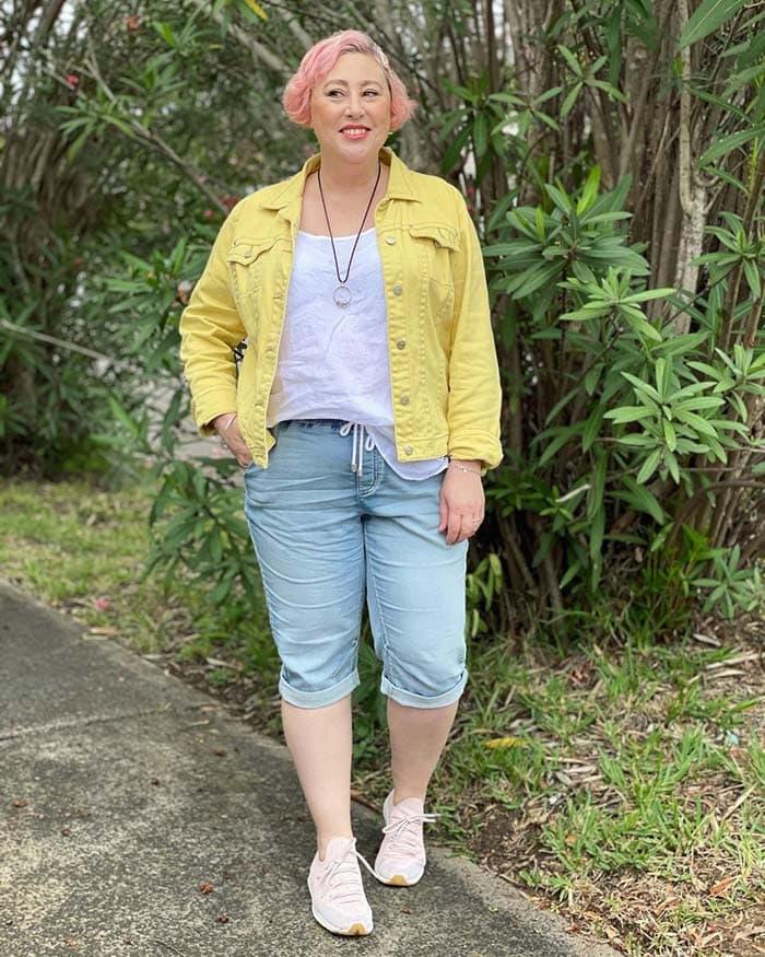 Kim wears a yellow denim jacket   40plusstyle.com