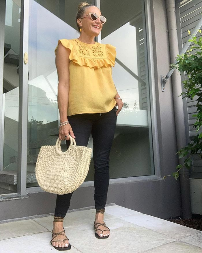 Melinda in a yellow top and dark jeans   40plusstyle.com