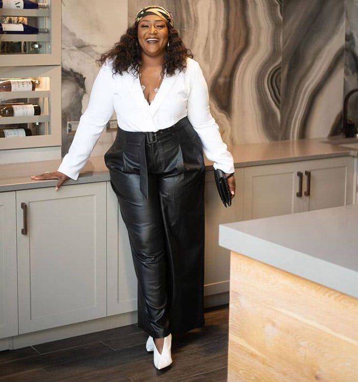 Nikki in a pair of leather pants and white top   40plusstyle.com