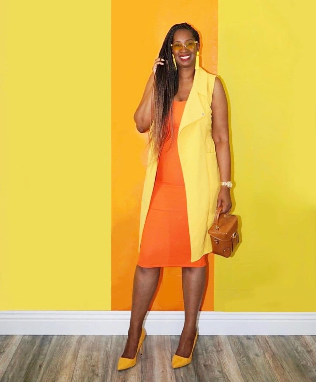Tanasha wears a bright outfit of yellow and orange   40plusstyle.com