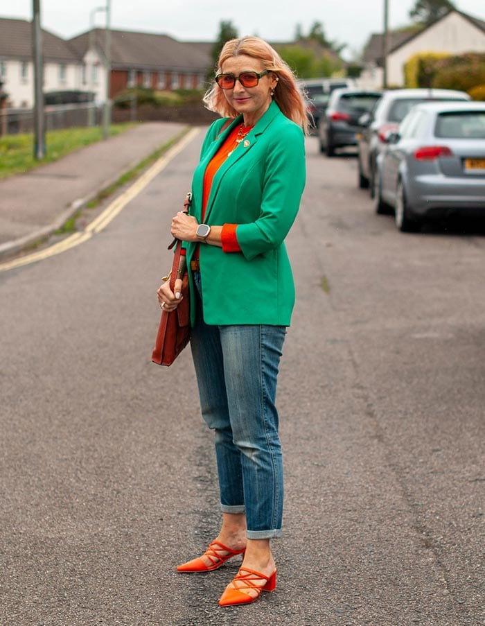 Catherine wearing green and orange   40plusstyle.com