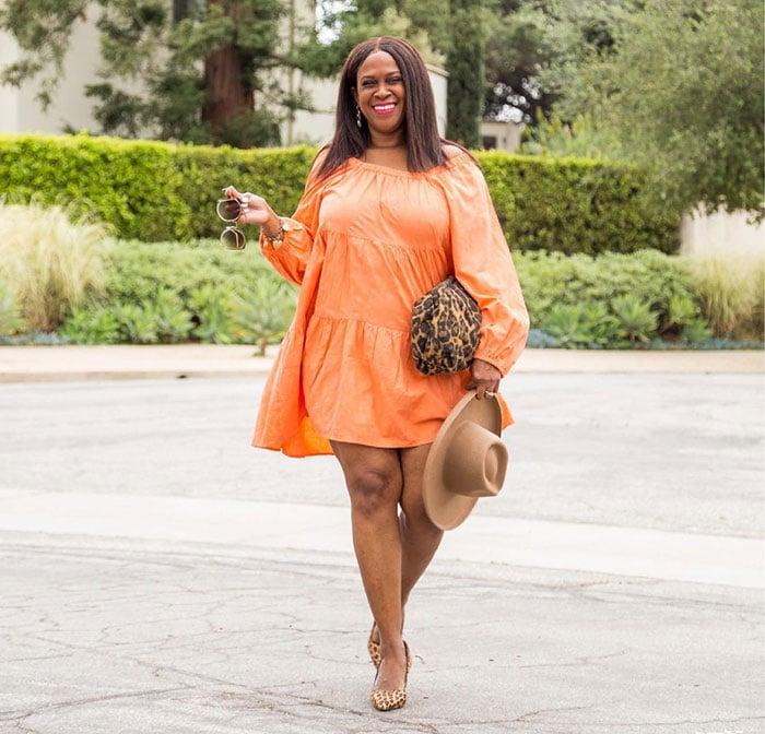 Julie in an orange dress   40plusstyle.com
