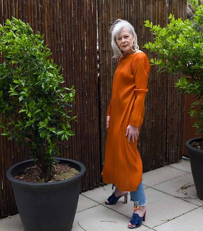 Dresses with pants - Lyn wearing a long dress with jeans | 40plusstyle.com