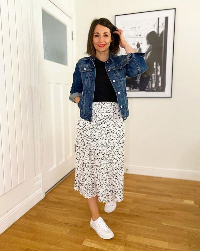 Nikki in a midi skirt and denim jacket   40plusstyle.com