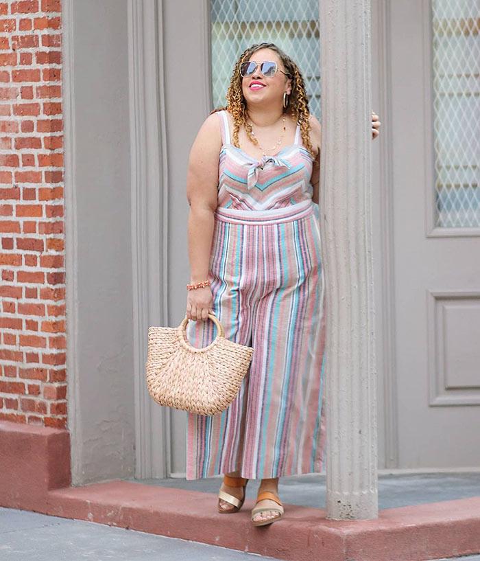 Summer jumpsuits for women - Sandra wears a striped jumpsuit | 40plusstyle.com