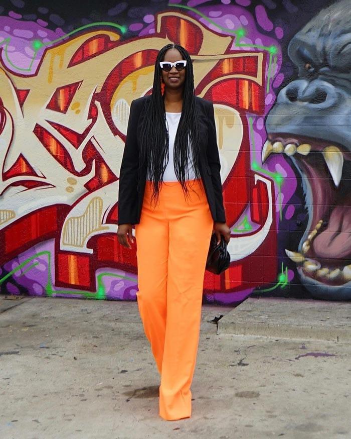 Tanasha in orange pants   40plusstyle.com