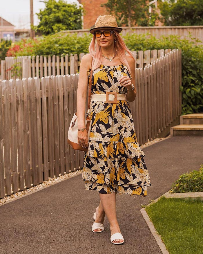 What to wear on a boat - Catherine wears a sundress and rattan accessories   40plusstyle.com