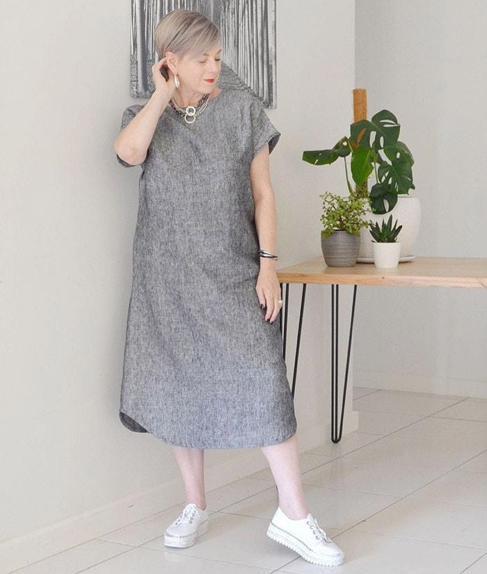 Deborah wears a gray dress   40plusstyle.com