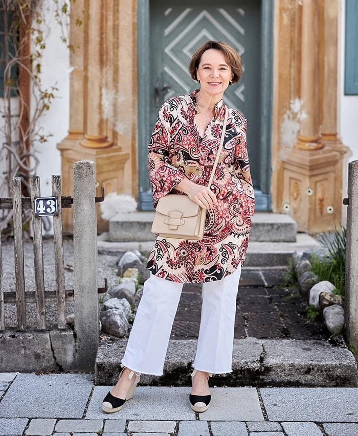 Anette in printed tunic, wide leg jeans and wedge sandals   40plusstyle.com