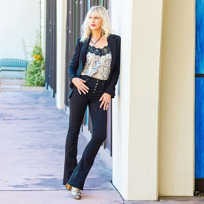 Catherine wears a blazer with her black jeans | 40plusstyle.com