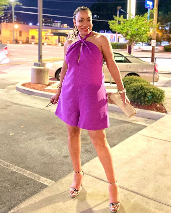Vegas outfits - Erica in a purple romper and heels | 40plusstyle.com